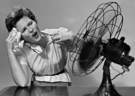 Hot flashes - Menopause / perimenopause woman in front of fan #perimenopause