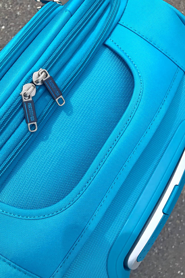 Cookies & Clogs | Travel | When flying, especially if you're doing international travel, it can be frustrating to meet baggage allowance limits and stay under a specific luggage weight. Using lightweight suitcases like the American Tourister iLite Max collection.
