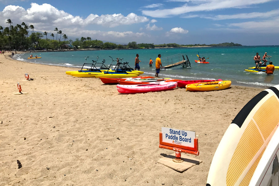 Cookies & Clogs | Oceans Sports Aloha Days offer 4 hours of unlimited water sports beach equipment including kayaks, stand-up paddleboards, snorkel gear, and rides on the glass bottom boat. One of the many things to do on the Big Island of Hawaii with kids.