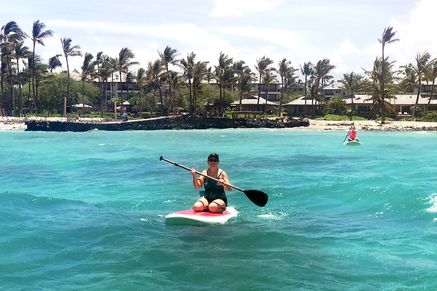 Cookies & Clogs | Oceans Sports Aloha Days offer 4 hours of unlimited water sports beach equipment including kayaks, stand-up paddleboards, snorkel gear, and rides on the glass bottom boat. One of the many things to do on the Big Island of Hawaii with kids. Standup paddleboarding SUP