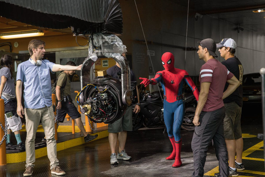 Cookies & Clogs | Exclusive Marvel Spider-Man Homecoming Interview with Tom Holland and Jacob Batalon during set visit in Atlanta, GA. Director Jon Watts with cast and crew on the set of Columbia Pictures' SPIDER-MAN: HOMECOMING.