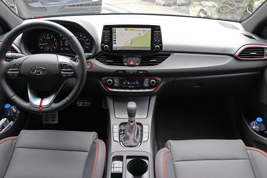 2018 Hyundai Elantra GT review. Interior dash with red accents.