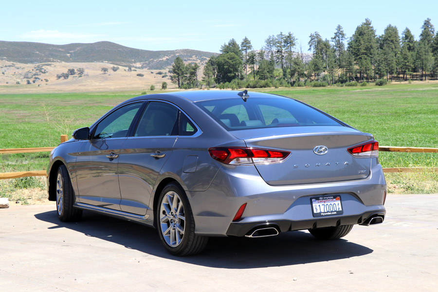 2018 Hyundai Sonata Sport dark gray sedan / car in field, back view