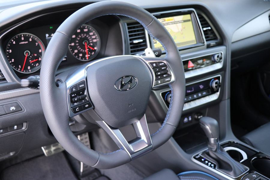 2018Hyundai Sonata Sport gray interior with D shape steering wheel and blue accents