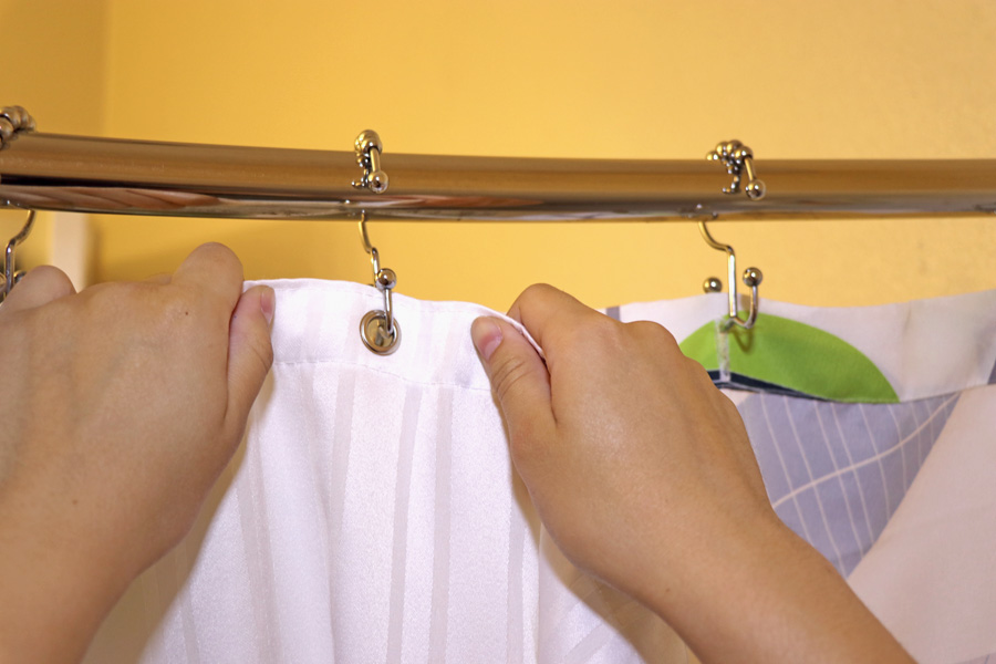 See how to use Clorox bleach for back to school cleaning - sanitize shower curtain liner.