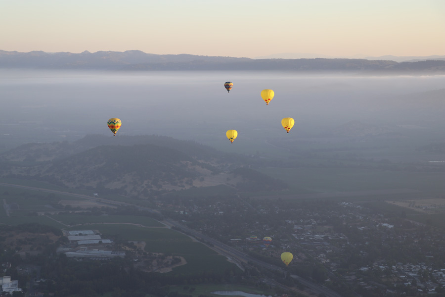 Hot air balloon ride over Napa Valley California slow ascension