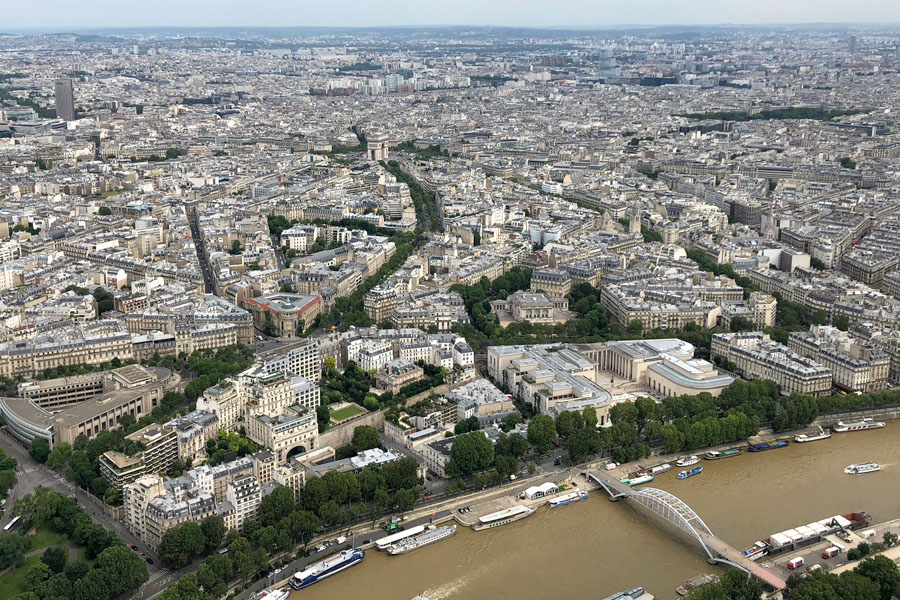 Paris Travel Guide: Top tips for how to visit the top of the Eiffel Tower in Paris France Paris overview with Arc de Triomphe