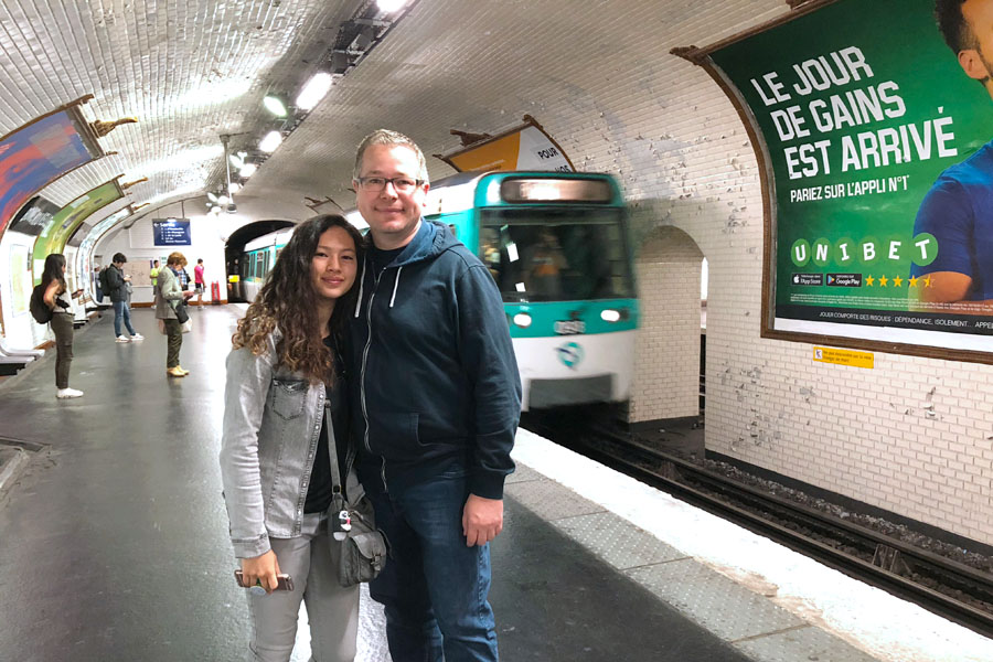 Paris Metro & Bus Public Transportation Guide: Father and daughter in Metro train tunnel.
