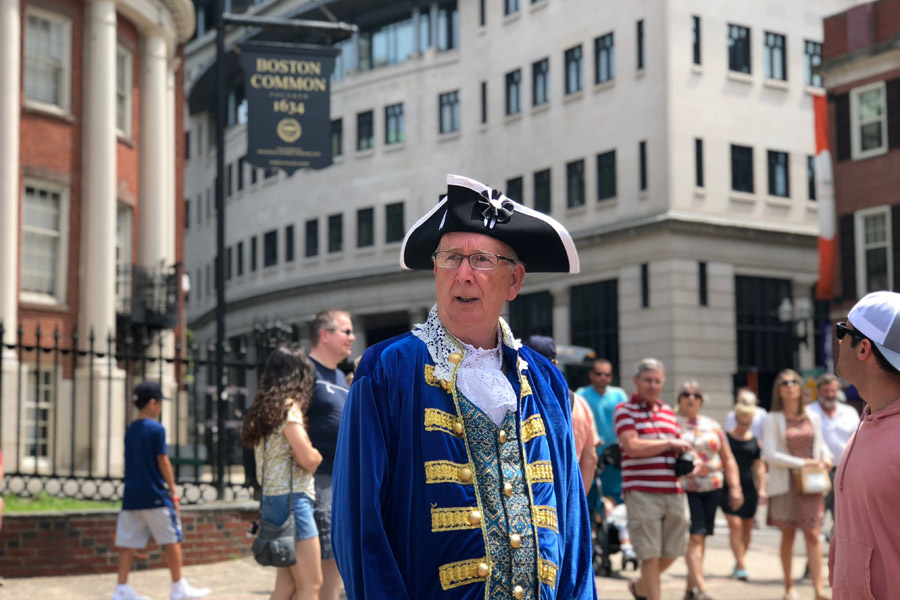 Family travel tips for visiting the Boston Freedom Trail in Boston, Massachusetts with historic sites - Boston common costume man