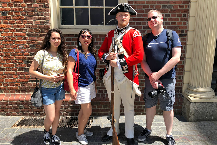 Family travel tips for visiting the Boston Freedom Trail in Boston, Massachusetts with historic sites - family with costume Red Coat Soldier