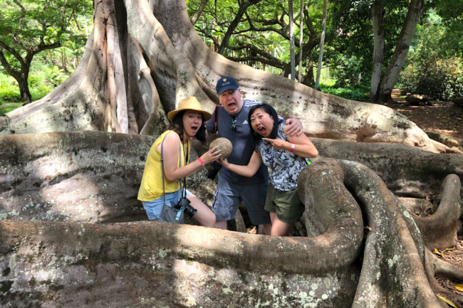Taking the Allerton Garden Tour in Lawai Valley on the South Shore. 1 of 3 National Tropical Botanical Gardens in Kauai Hawaii. Jurassic Park Moreton Bay Fig Trees Dinosaur Egg Family Photo
