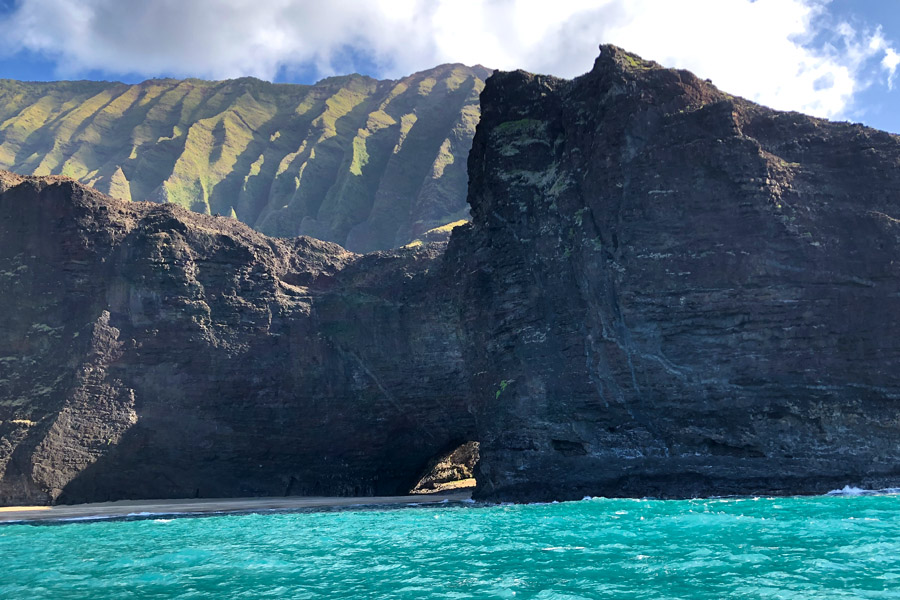Top things to do in Kauai Hawaii — Kauai Napali Coast boat tour / Na Pali Coast sunset cruise Arch Pirates of Caribbean