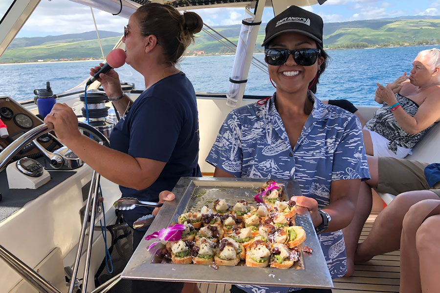 Top things to do in Kauai Hawaii — Kauai Napali Coast boat tour / Na Pali Coast sunset cruise captain crew and appetizer