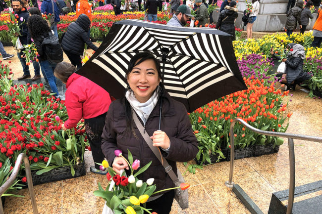 2020 Flower Bulb Day in San Francisco on March 7th! at Union Square in San Francisco on March 7. Photo from 2019 free tulips event chinese woman with umbrella and tulips.